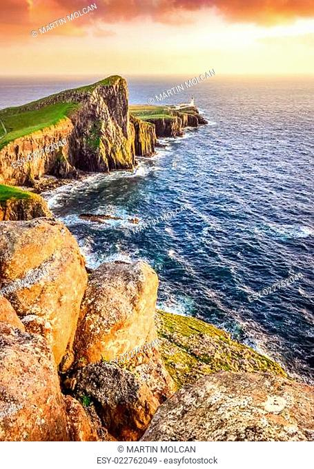 Vertical view of Neist Point lighthouse with rocks foreground, Scotland