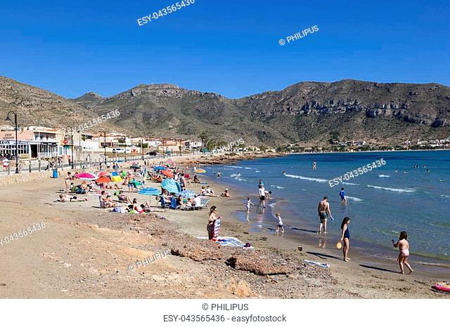 Azohia, Spain - May 14, 2017: People relaxing on the small beach in town La Azohia. Province of Murcia, southern Spain