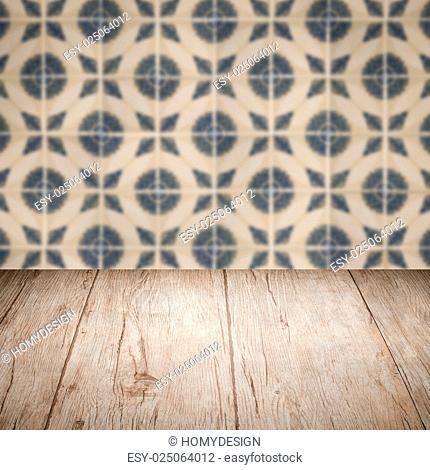Empty wood table top and blur vintage ceramic tile pattern wall in background, Mock up template for display of your product