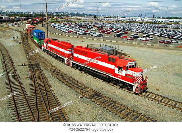 Tacoma Rail locomotives pulling a string of containers in the yard in the Port of Tacoma