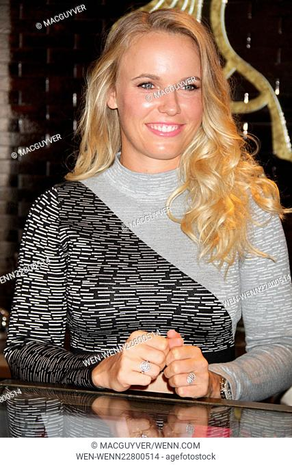 Godiva Chocolatier's ambassador and tennis star, Caroline Wozniacki makes an appearance at the MetLife Godiva Boutique to promote the brand's soft serve ice...