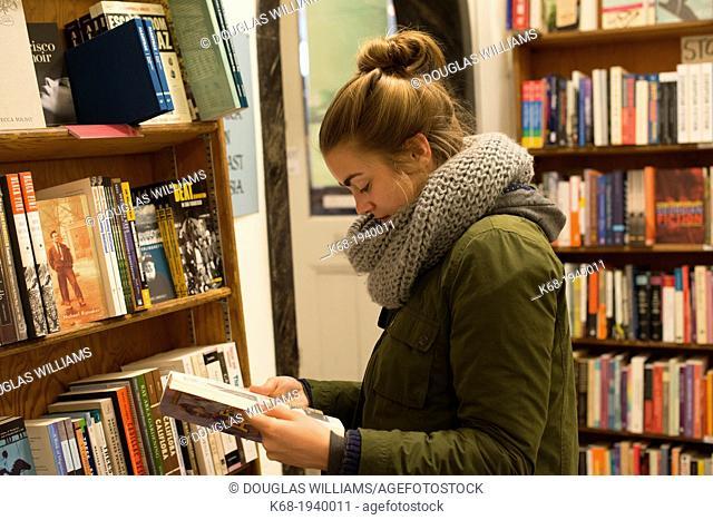Teenage girl, 17, in City Lights Bookstore, North Beach, San Francisco, California, USA