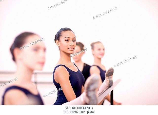 Teenage ballerinas practicing at the barre