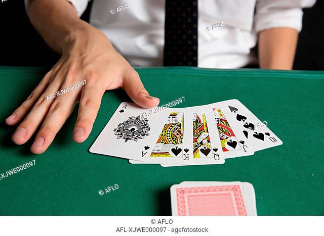 Young Japanese man gambling