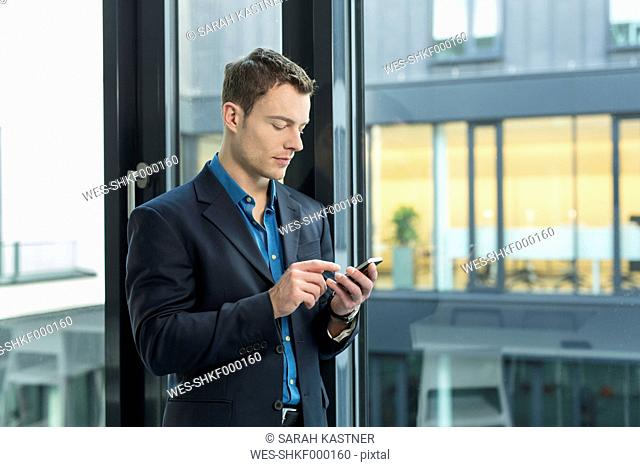 Businessman using smartphone in an office