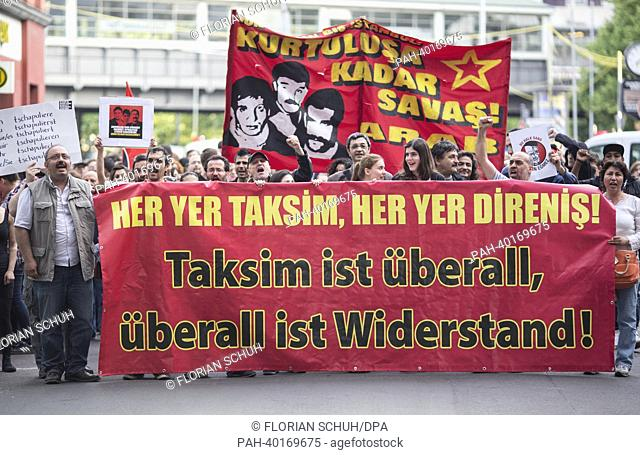 'Taksim is everywhere, resistance is everywhere' is written on a banner of protesters at a demonstration in Kreuzberg, Germany, 11 June 2013