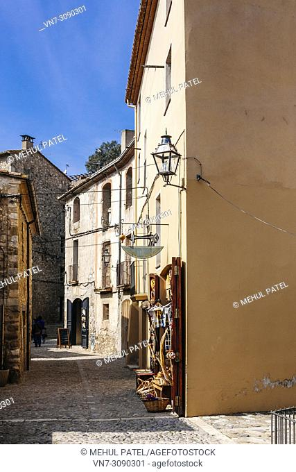 Narrow cobbled street in the old medieval town of Besalu, Girona, Catalonia, Spain