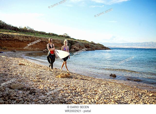 Female surfers on beach