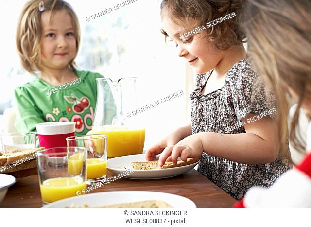Little children at breakfast table