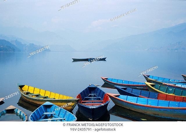 Boats on a lake called Phewa Tal ( Pokhara, Nepal)