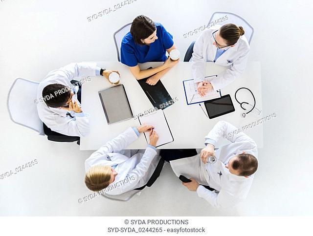 group of doctors having coffee break at hospital