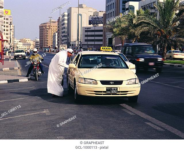 Arab businessman catching a taxi