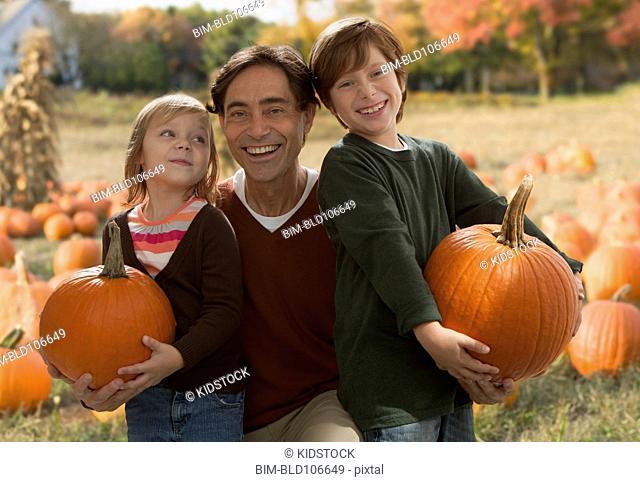 Caucasian family at pumpkin patch