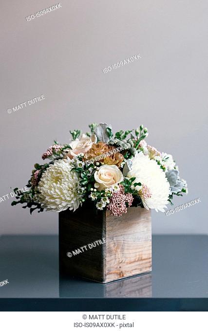 Flower arrangement in wooden box, close-up