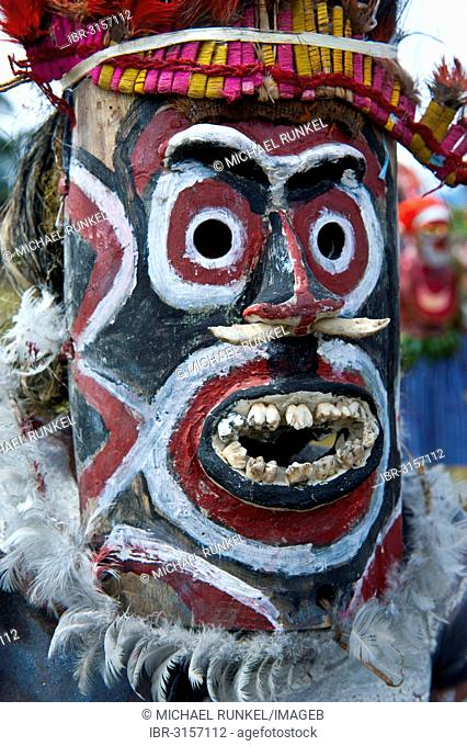 Member of a tribe with a mask at the traditional sing-sing gathering
