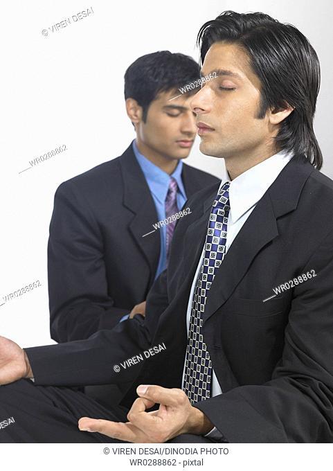 South Asian Indian executive men doing yoga MR