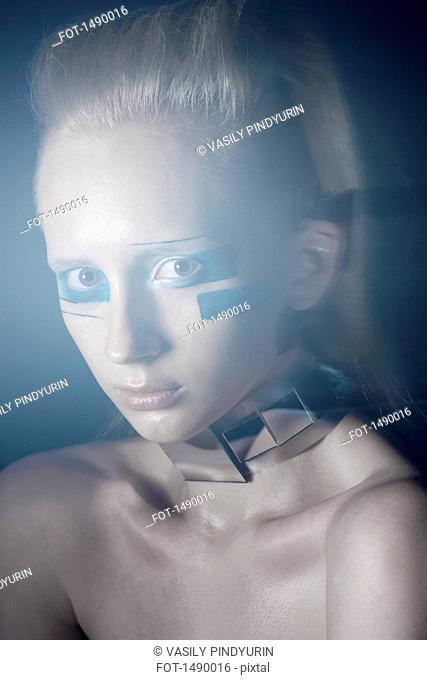 Close-up portrait of confident fashion model