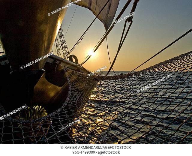 Bergantin Thalassa sailing at sunset