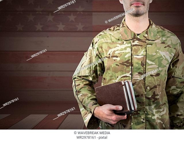 Military holding books against 3D american flag