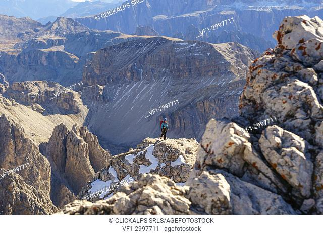 A alpin climber along via ferrata of Sass Rigais. Odle group, Val Gardena, Tretino Alto Adige, Italy