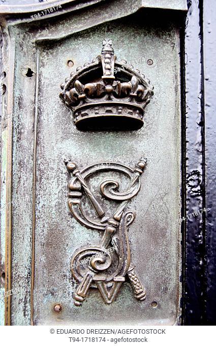 Close-up of the keyhole in the iron gate surrounding Buckingham Palace, London