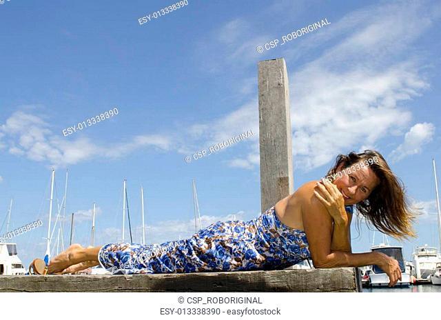Sexy mature woman at marina