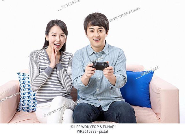 Young smiling cou enjoying video game