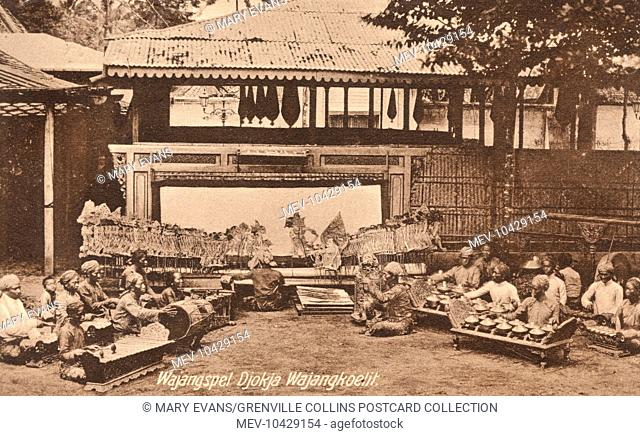 Garoet, Indonesia - Puppet Theatre and musicians forming a Gamelan orchestra