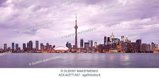 Toronto downtown skyline at sunset, CN tower, panoramic city scenery. Toronto, Ontario, Canada 2013