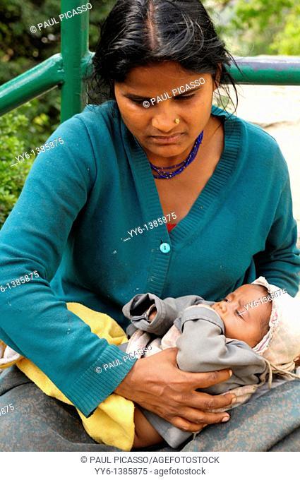 nepalis lady holding her baby and begging, the nepalis , life in kathmandu , kathmandu street life , nepal