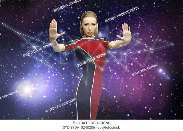 futuristic woman over planet and stars in space