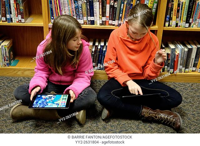 Preteen Girls Using iPads for Coding School Assignment, Wellsville, New York, USA