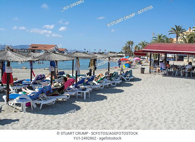 Sunbathers on the beach at Los Alcazares in Murcia