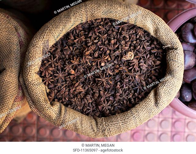 Star anise in a jute sack at an Indian street market