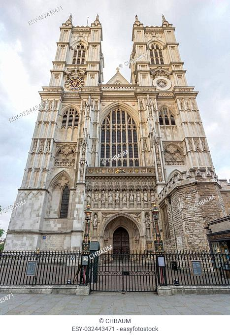 Frontal view of world famous Westminster Abbey cathedral, next to Big Ben and the Houses of Parliament, London, England