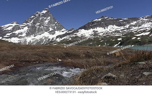 Alpine stream and Mount Cervino or Matterhorn, Aosta Valley, Italy