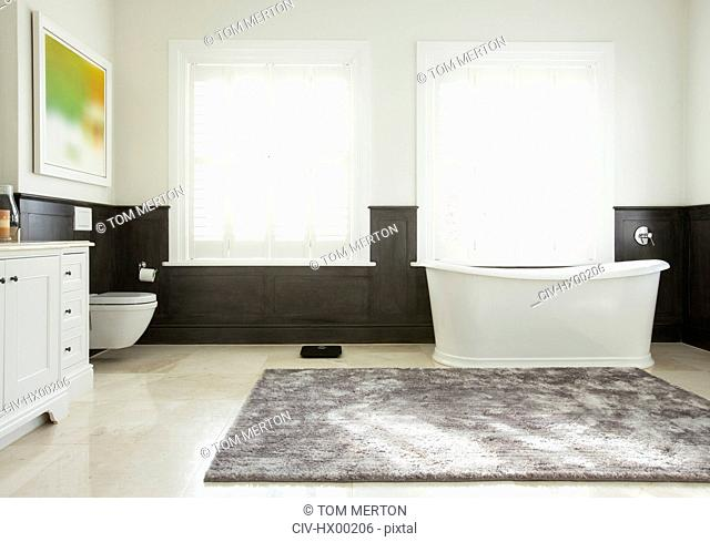 Soaking tub in luxury bathroom