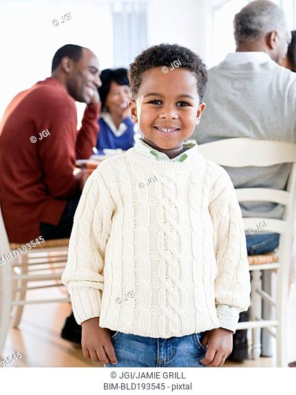 African American boy smiling with family in background