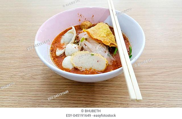 Noodle bowl placed on a wooden table