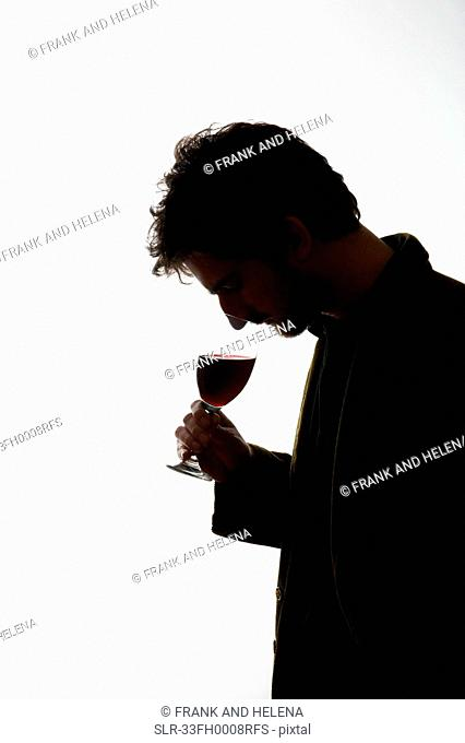 Man drinking glass of wine