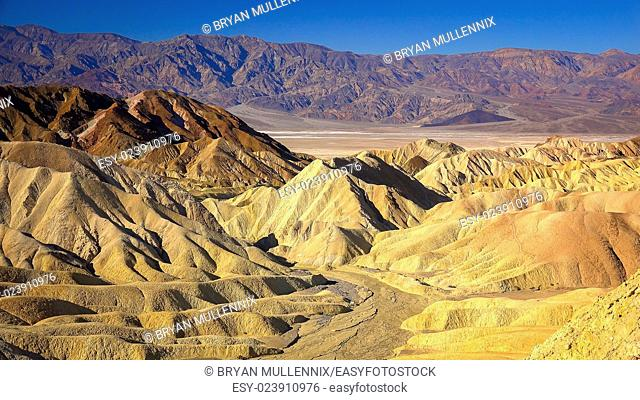 The view from Zabriskie Point in Death Valley National Park shows rugged hills formed by erosion