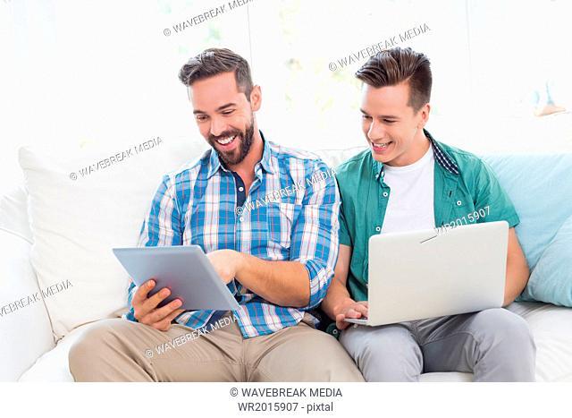 Homosexual couple men working on laptop