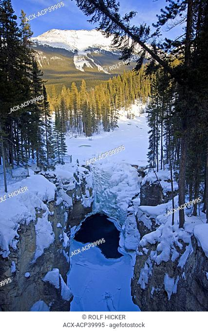 Snow and ice covered Sunwapta Falls along the Sunwapta River, Icefields Parkway, Jasper National Park, Canadian Rocky Mountains, Canadian Rocky Mountains