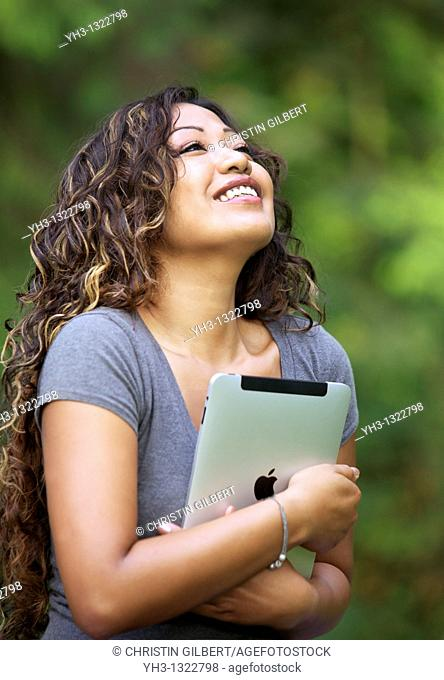 Close up of a happy young woman hand holding an iPad