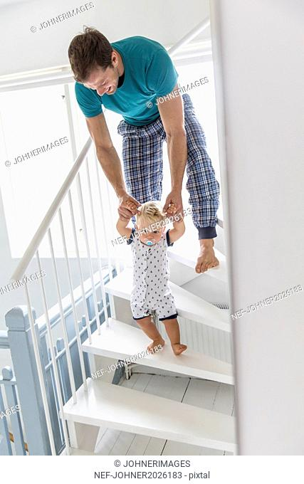 Father with son on stairs