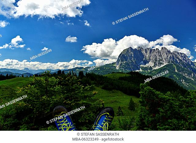 Wilder Kaiser mountain, blue hiking boots on the edge of the picture
