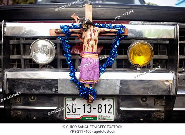 An image of crucified Jesus Christ decorates a truck at the pilgrimage to Our Lady of Guadalupe Basilica in Mexico City, Mexico, December 11, 2013