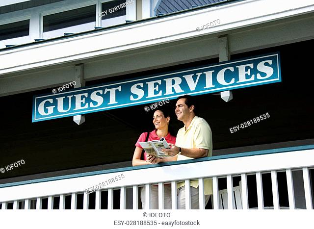 Mid-adult Caucasian couple looking out at guest services at Bald Head Island, North Carolina
