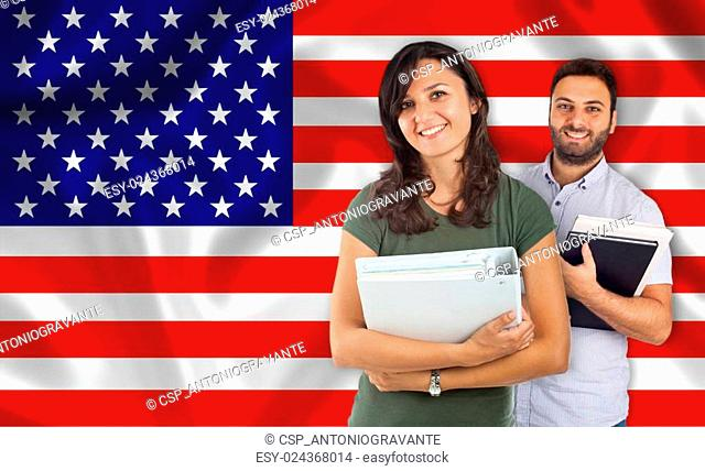 Couple of students over United States flag