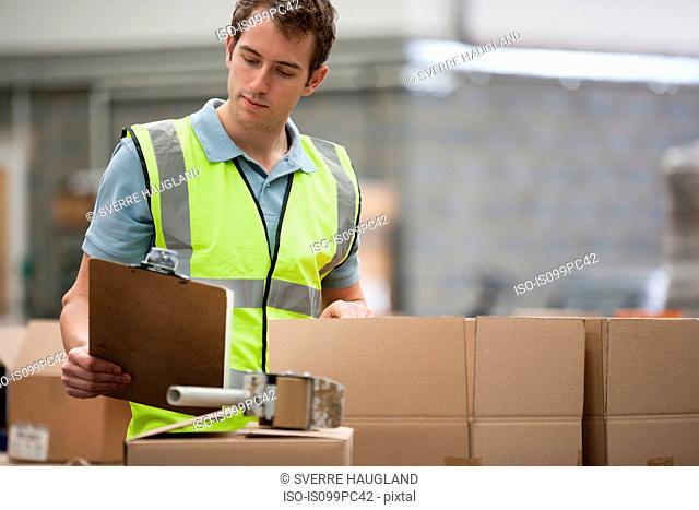 Man checking cardboard boxes